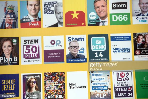 A billboard showing campaign flyers from various Dutch political parties is displayed near the Dutch parliament building on March 14 2017 in The...