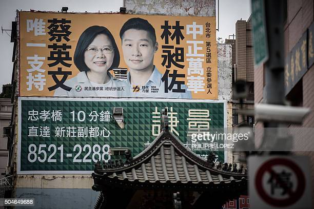 A billboard showing Democratic Progressive Party presidential candidate Tsai Ingwen is displayed on a building in Taipei on January 12 2016 Taiwan's...