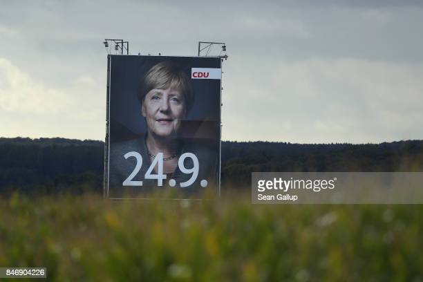 A billboard showing German Chancellor and Christian Democrat Angela Merkel and the numbers 249 which is the date of upcoming German federal elections...