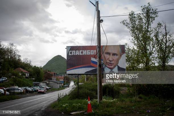 A billboard showing the portrait of Russian president Vladimir Putin is seen on a road towards Belgrade on the outskirts of the majority ethnicSerb...