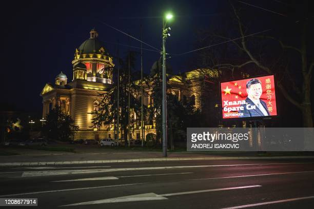 Billboard shows Chinese President Xi Jinping next to the National Assembly building in Belgrade on March 30 as Serbia has introduced curfew from 5 pm...