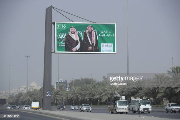 A billboard shows Saudi King Salman bin Abdulaziz and Saudi Crown Prince Mohammad Bin Salman hanging over a highway on June 20 2018 in Riyadh Saudi...