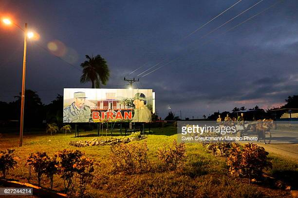 A billboard shows the photos of Cubas former President and Revolution leader late Fidel Castro and his brother Cubas President Raul Castro at a...