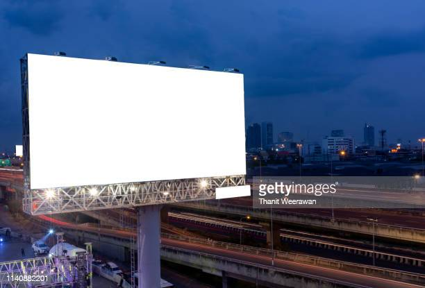 billboard street on light trails for outdoor advertising poster or blank billboard at night time for advertisement. street light. - billboard stock pictures, royalty-free photos & images