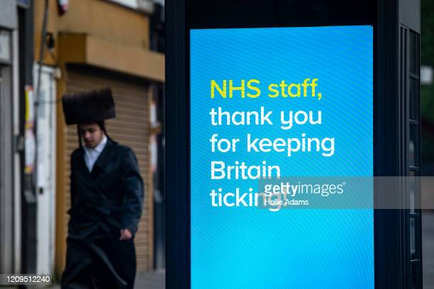 Billboard thank NHS staff in Stamford Hill on the evening of the Jewish holiday of Passover on April 8, 2020 in London, England. The Jewish community...