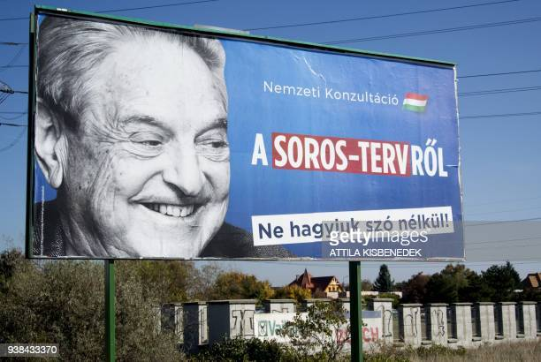 A billboard with a poster of HungarianAmerican billionaire and philanthropist George Soros with the lettering National consultation about the Soros'...