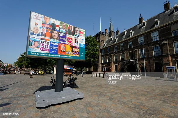billboard with election posters in the hague - europa geografische locatie stockfoto's en -beelden