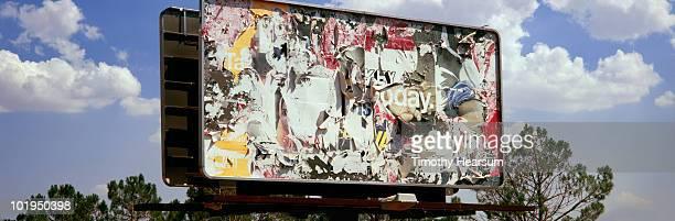 billboard with multiple layers peeling away - timothy hearsum stock-fotos und bilder