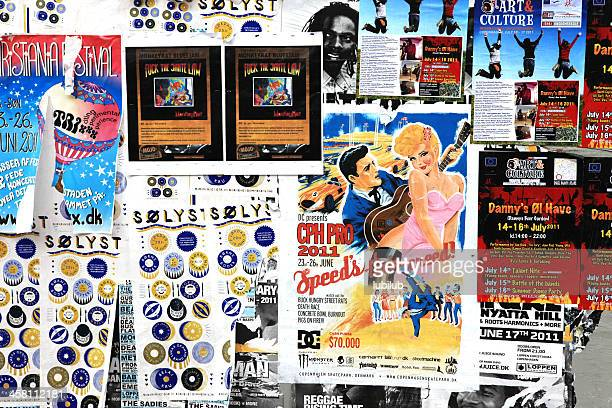 billboard with posters advertising for culture, music and art - poster stock photos and pictures