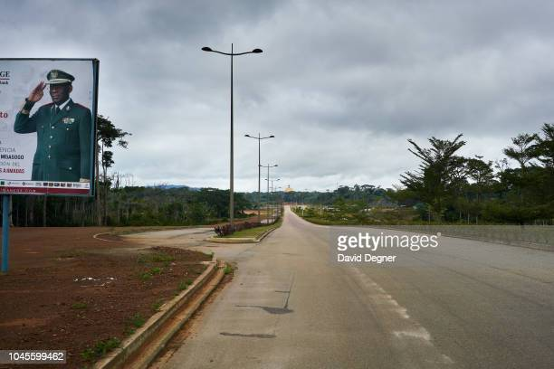 A billboard with president Teodoro Obiang Nguema Mbasogo stands over the empty streets of the new capital city on August 16 2018 in Oyala Equatorial...