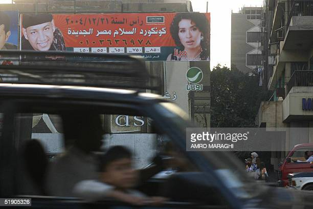 Billboards advertise 31 December 2004 Lebanese singer Assi Hellani's newly released album and a New Year party with Egyptian belly dancer Dina and...