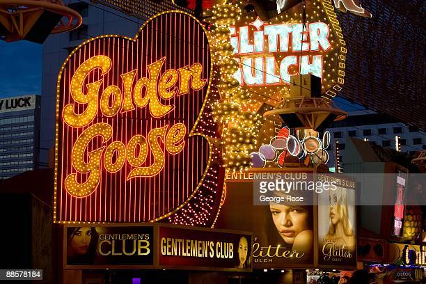 Billboards and neon promoting a gentleman's club part of the Fremont Street Experience located in downtown are seen in this 2009 Las Vegas Nevada...