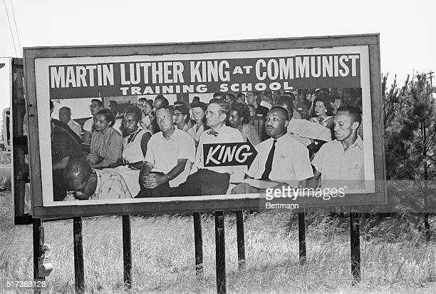 Billboards claiming to identify Dr Martin Luther King Jr at a communist training school stand on the route from Selma Alabama to Montgomery taken by...