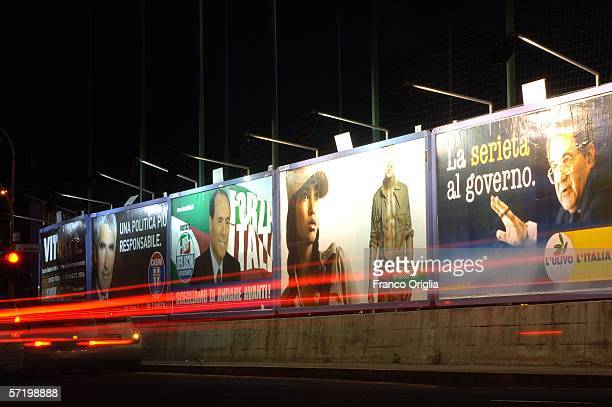 Billboards display images of the Italian Prime Minister, Silvio Berlusconi , and of former European Commission President, Romano Prodi, on March 28,...