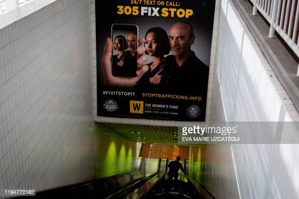 Billboards displaying a campaign against human trafficking are seen at Knight Center Metrorail station in Downtown Miami on January 9 2020 Every year...