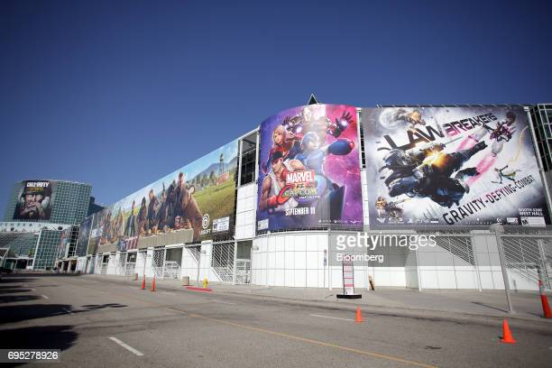 Billboards displaying video game advertisements hang outside the Los Angeles Convention Center ahead of an Ubisoft Entertainment SA event in Los...