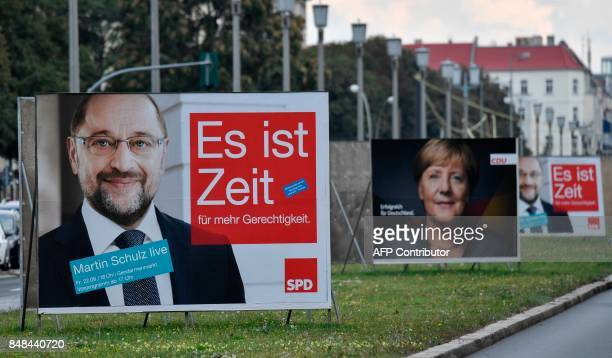 Billboards featuring German Chancellor and leader of the conservative Christian Democratic Union party Angela Merkel and Martin Schulz leader of...