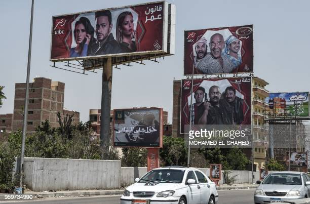 Billboards for TV Ramadan series are seen in the streets of the Egyptian capital Cairo on May 15 2018 Soaps and dramas normally united bingewatching...