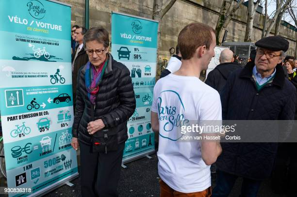 Billboards indicate the differences between cars vs bicycles on March 10 2018 in Paris France Pedestrians and cyclists assembled to support a carfree...