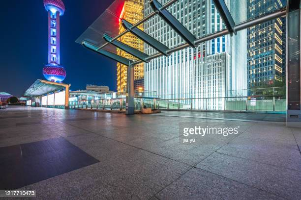 billboards on sidewalks in lujiazui financial district, pudong, shanghai. night. - shanghai billboard stock pictures, royalty-free photos & images