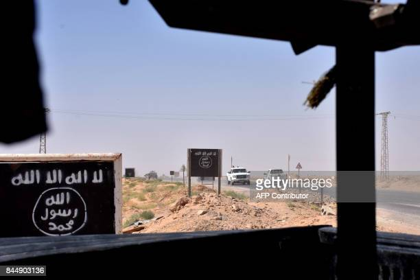 Billboards show the logo of the Islamic State group near the village of alMaleha in the northern countryside of Deir Ezzor where Syrian progovernment...