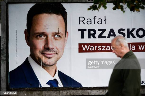 A billdoard is seen with mayoral candidate Rafal Trzaskowski with a star of David drawn on it in Warsaw Poland on October 17 2018 On October 21st...