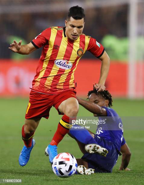 Billel Bensaha of Esperance Sportive de Tunis runs from Andre Carrillo of Al Hilal SFC during the FIFA Club World Cup 2nd round match between Al...