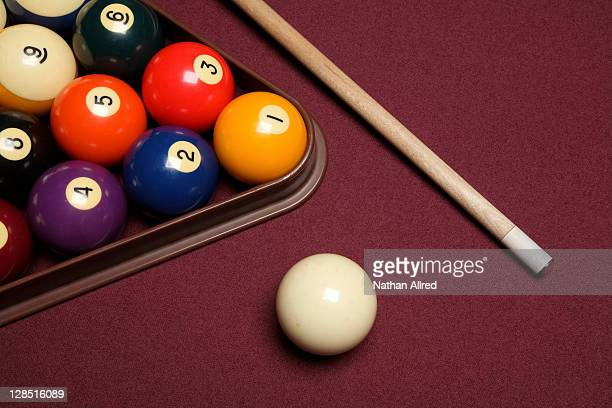 Billiard pool table with cue stick triangle and balls