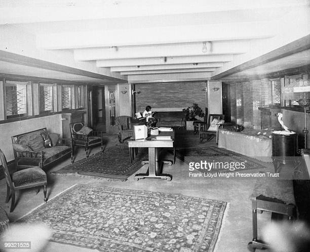 Billiards Room looking east with Jeannette Wilber sitting by fireplace playing instrument Nonoriginal Oriental rugs and furniture in room Chicago...