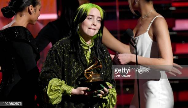 Billie Eilish accepts Record of the year for Bad Guy onstage with Alicia Keys and Dua Lipa during the 62nd Annual GRAMMY Awards at Staples Center on...