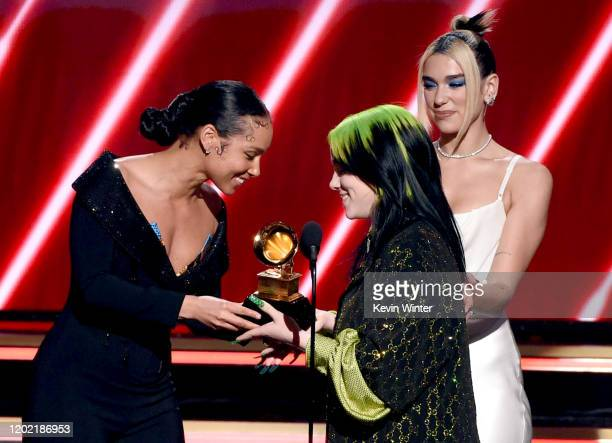 Billie Eilish accepts the Best New Artist award from Alicia Keys and Dua Lipa onstage during the 62nd Annual GRAMMY Awards at STAPLES Center on...
