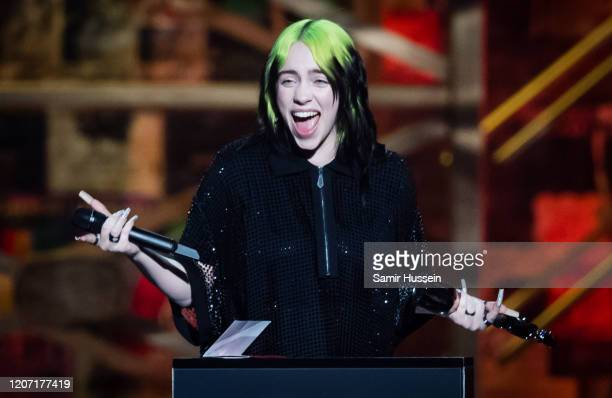 Billie Eilish accepts the International Female Solo Artist award during The BRIT Awards 2020 at The O2 Arena on February 18 2020 in London England