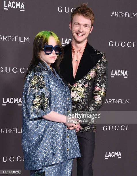 Billie Eilish and brother Finneas O'Connell arrive at the 2019 LACMA Art Film Gala Presented By Gucci at LACMA on November 2 2019 in Los Angeles...