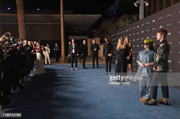 Billie Eilish and FINNEAS both wearing Gucci attend the 2019 LACMA Art Film Gala Presented By Gucci at LACMA on November 02 2019 in Los Angeles...