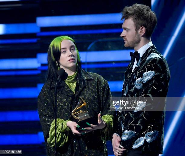 Billie Eilish and Finneas O'Connell accept the Song of the Year award for 'Bad Guy' onstage during the 62nd Annual GRAMMY Awards at Staples Center on...