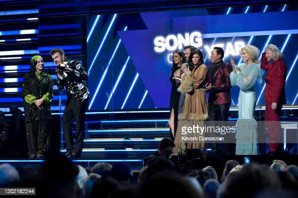 Billie Eilish and Finneas O'Connell accept the Song Of The Year award for Bad Guy from Smokey Robinson with Jimi Westbrook Karen Fairchild Kimberly...