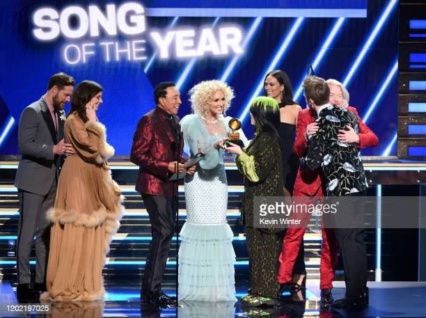 Billie Eilish and Finneas O'Connell accept the Song of the Year award for 'Bad Guy' from Jimi Westbrook Karen Fairchild Smokey Robinson Kimberly...