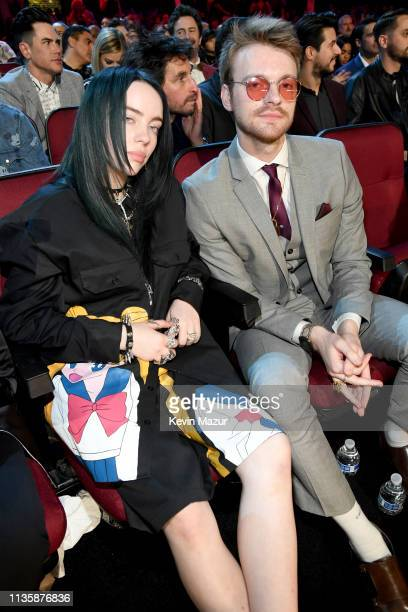 Billie Eilish and Finneas O'Connell attend the 2019 iHeartRadio Music Awards which broadcasted live on FOX at Microsoft Theater on March 14 2019 in...