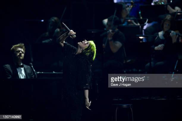 Billie Eilish and Finneas O'Connell perform at The BRIT Awards 2020 at The O2 Arena on February 18 2020 in London England