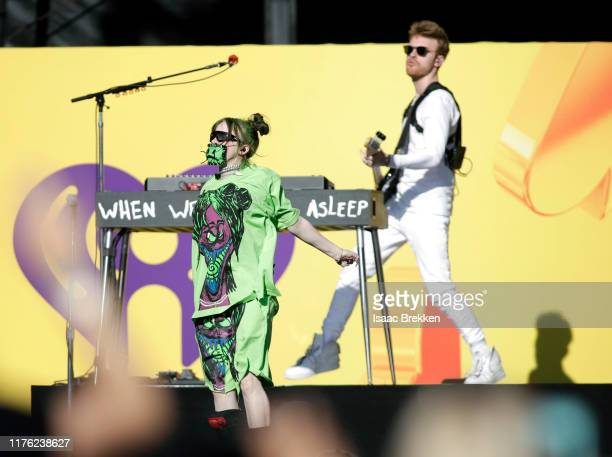 Billie Eilish and Finneas O'Connell perform onstage during the Daytime Stage at the 2019 iHeartRadio Music Festival held at the Las Vegas Festival...