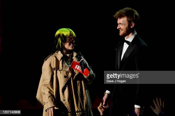 Billie Eilish and Finneas O'Connell present an award at The BRIT Awards 2020 at The O2 Arena on February 18 2020 in London England
