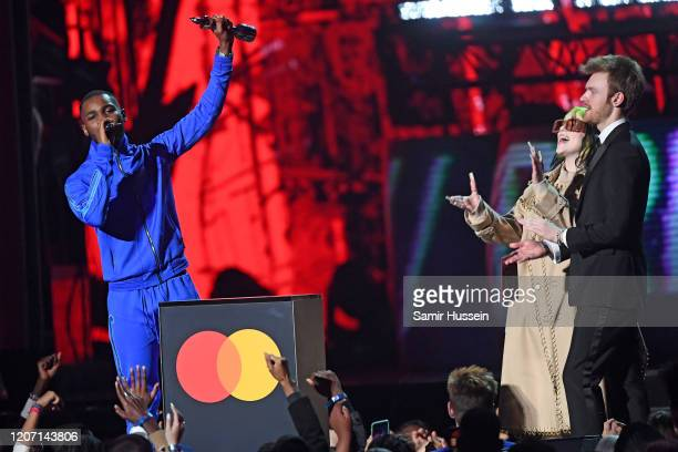 Billie Eilish and Finneas O'Connell present Dave Mastercard Album of The Year during The BRIT Awards 2020 at The O2 Arena on February 18 2020 in...