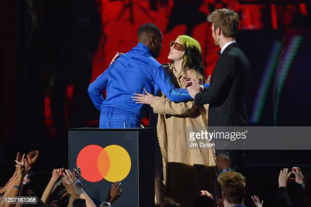 Billie Eilish and Finneas O'Connell present Mastercard Album of The Year to Dave during The BRIT Awards 2020 at The O2 Arena on February 18 2020 in...