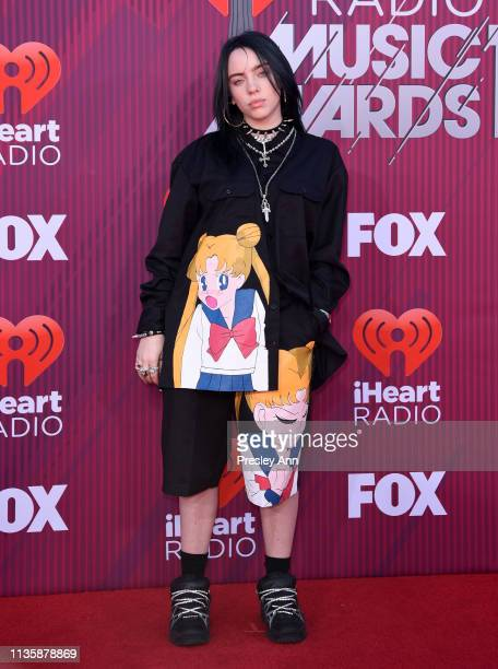 Billie Eilish attends the 2019 iHeartRadio Music Awards which broadcasted live on FOX at Microsoft Theater on March 14 2019 in Los Angeles California
