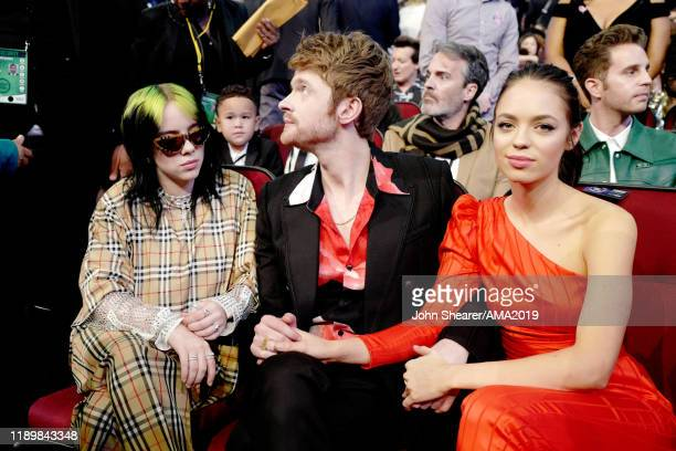 Billie Eilish Finneas O'Connell and Claudia Sulewski attend the 2019 American Music Awards at Microsoft Theater on November 24 2019 in Los Angeles...