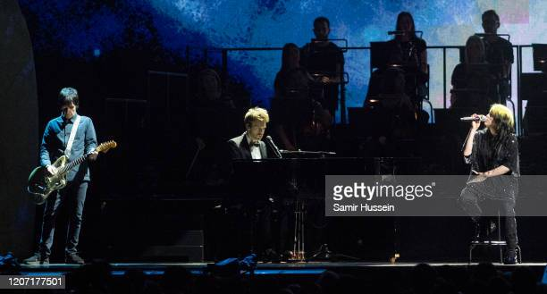 Billie Eilish , Finneas O'Connell and Johnny Marr perform during The BRIT Awards 2020 at The O2 Arena on February 18, 2020 in London, England.