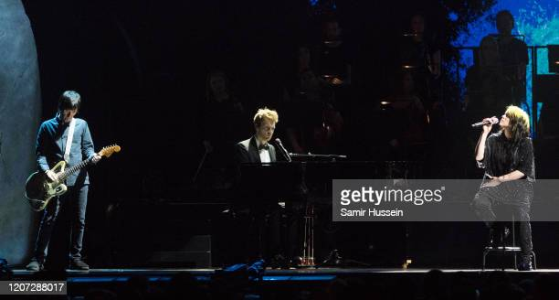 Billie Eilish Finneas O'Connell and Johnny Marr perform during The BRIT Awards 2020 at The O2 Arena on February 18 2020 in London England