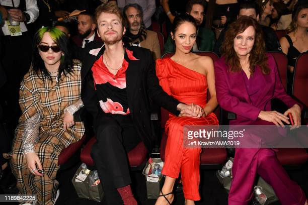 Billie Eilish Finneas O'Connell Claudia Sulewski and Maggie May attend the 2019 American Music Awards at Microsoft Theater on November 24 2019 in Los...