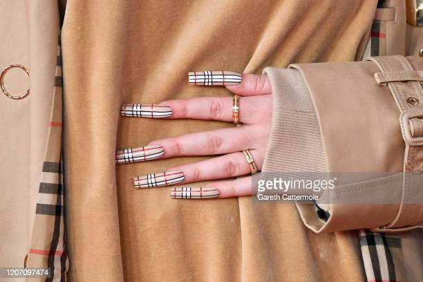 Billie Eilish, nails details, attends The BRIT Awards 2020 at The O2 Arena on February 18, 2020 in London, England.