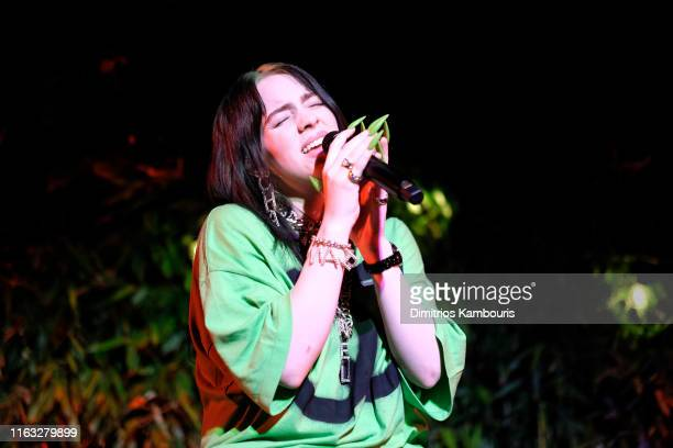 Billie Eilish performing at the event wears a printed black and white jumpsuit Look 56 from the FallWinter 2019/20 act 1 ReadytoWear Collection with...